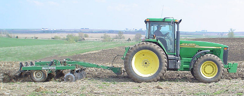 John Deere tractor and chisel plough